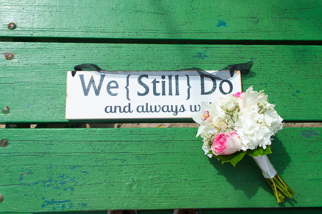 We Still Do and Always Will vow renewal sign for beach ceremony